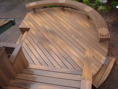 Here's a fresh take on decking layouts...the curved bench frames the deck perimeter. This is Fiberon composite decking in Horizon 'Ipe'.  #deckideas