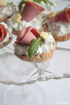 roast beef bites  Filling is cream cheese, sour cream, horseradish, finely chopped parsley, finely diced pickles and roasted beef steak .   try Smoked salmon if you do not want to use meat.  Cheese flower.