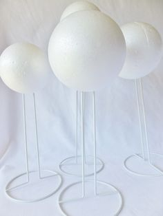 Awesome idea for a hat stand! Doll stand base and a styrofoam ball!