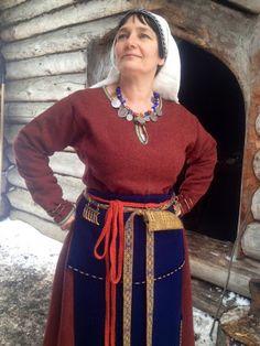 The belt and pendants are dressed on. Picture taken in Pukkisaari iron age village, Helsinki Finland - Hibernaatiopesäke