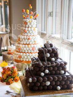 cake pop cake-add top tier or real cake to cut and have a groom's cake