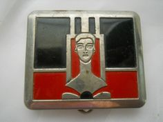 Mouse over image to zoom     				  Zoom InZoom Out  Sell one like this  	 	  Antique Art Deco Bakelite Red & Black Lady Makeup Compact
