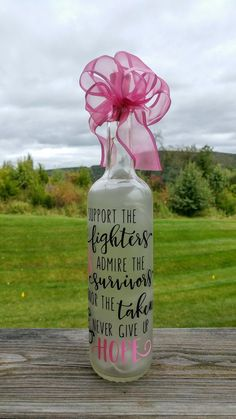 Donation to the American Cancer Society.Supporter for Cancer Recycled Glass Bottles, Painted Wine Bottles, Lighted Wine Bottles, Bottle Lights, Bottles And Jars, Decorated Bottles, Bottle Lamps, Mason Jars, Alcohol Bottle Crafts