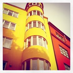 Apartment Building, Oslo, Norway  love the vibrant color and all the windows!!