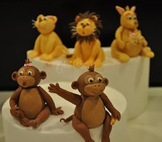Fondant or marzipan monkey tutorial-also have the Martha Stewart page ripped out -think there will be a monkey riding his dump truck cake this year