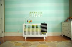 Aqua Stripe Accent Wall in this Cheerful Monster Nursery