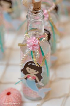 Mermaid message in a bottle from Pastel Mermaid Birthday Party at Kara's Party Ideas. See the ocean of details at karaspartyideas.com!
