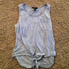 a soft and lavender shirt from forever 21 very stylish & will look very good in the summer with some shorts! Forever 21 Tops Tank Tops