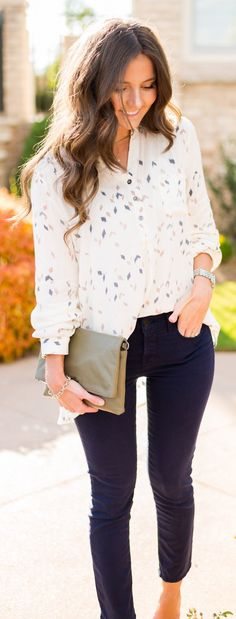 White Printed Shirt / Red Skinny Jeans / Green Leather Clutch