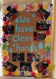 Washing hands display. The children painted their hands with paint and made hand prints for the border. Then we took photos of them washing their hands in the sink.