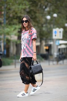 How To Dress Like An Italian Girl — 50+ Lessons Worth Knowing #refinery29 http://www.refinery29.com/2014/09/74945/milan-fashion-week-2014-street-style#slide35 Choose a pair of sneakers instead of heels the next time you're in a spangly get-up.