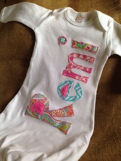 A personal favorite from my Etsy shop https://www.etsy.com/listing/273465388/personalized-applique-infant-baby-girl