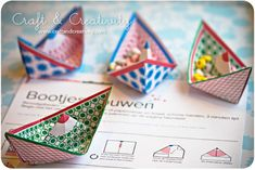 Handmade paper boats - filled with the beads from a candy necklace. Wonderful idea.
