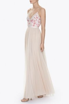 The Prairie Embroidery artwork is based on springtime floral meadows and French Impressionist flower paintings. The floral motifs are embroidered in soft yet vivid tones of pink with white highlights. These are bordered by lace inspired motifs in whites and chalks. The bodice of this maxi dress is delicately fitted with a plunging v-neck and semi sheer lace insert detailing. The full skirt is made up of layers of tulle creating dramatic yet soft movement, finishing at the waist with our…