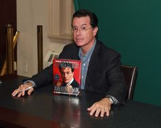 Stephen Colbert poses with his new book 'America Again'.