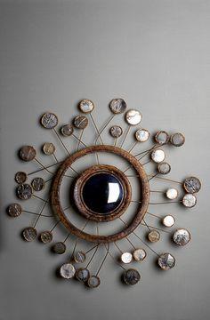 "Miroir ""Satellite"" par Line Vautrin, vers 1960. ""Satellite"" Mirror by Line Vautrin, circa 1960."