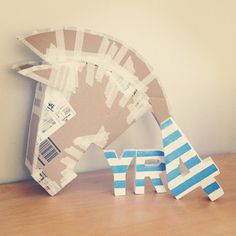 A cardboard Trojan horse head for a book display and 'Year 4' letters for the classroom door.