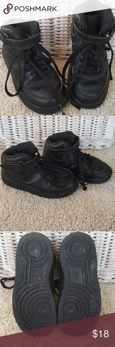 Nike Air Force 1 Mid Rise Sneaker Size 12C Little boys Nike Air Force 1 mid rise all black sneaker. Very good used condition. Good tread. Plastic tips missing from one shoelace. Nike fabric logo on tongue snagged from velcro. From a smoke-free home. Nike Shoes Sneakers