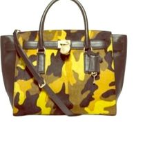 $220 Michael Kors Hamilton Trvlr Camo/Calf Hair MAKE AN OFFER! NEW! Need new loving❤️home for this beautiful Authentic MK calf hair & black leather Camo bag.(two sided) tags still attached.She has never been worn.                                                                                                      INCLUDES: Calfhair Purse,Dustbag, pricetag attached, shopping bag,care card, lock&key,detachable crossbody strap.Would make a great gift too! This is discontinued Michael Kors Bags