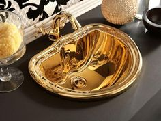 golden sink and bathroom fixtures are modern room decorating ideas for the year of the dragon Royal Bathroom, Zen Bathroom, Laundry In Bathroom, Bathroom Fixtures, Feng Shui Colours, Retro Bathrooms, Year Of The Dragon, Modern Room, Colorful Interiors