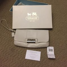Large White coach leather wristlet Used a handful of times for special occasions, still have tags and box that came with purchase. No dust bag. Coach Bags Clutches & Wristlets