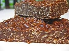 """They call it a """"Chocolate Granola Bar"""" but lets face it.it's candy, its delicious and tastes like an Eatmore Bar and there is nothing healthy about it Köstliche Desserts, Delicious Desserts, Yummy Food, Protein Snacks, Healthy Snacks, Yummy Treats, Sweet Treats, Chocolate Granola, Chocolate Bars"""