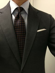 Dark grey suit, light blue shirt, navy tie with medallions...love this look. Would change the tie to dark navy!