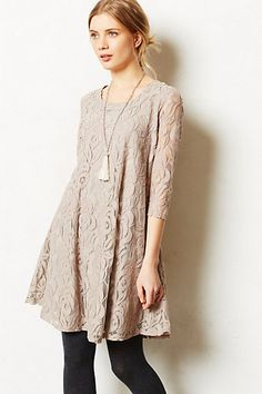 dresses like this inspire whole outfits... a dangly necklace like on the model or a statement gold necklace, tights and neutral booties! paired with a little moto jacket