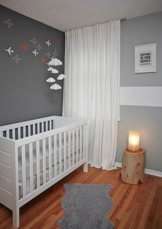 A sleek grey contemporary nursery. The airplanes on the wall are just the thing for a little boy.   Simplicity is the key in this grey nursery #babyNursery