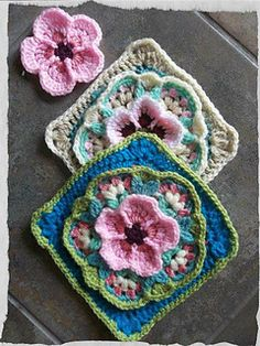 This is an afghan square design based on the granny square. Originally it was a design I dreamed up for a cushion cover. I never wrote the pattern down and quite a few people have asked for it. So this is the revisited cushion square. It's unique in that it's a five-petal flower motif design, rounded off and squared. Which, as a novice crocheter was quite a challenge for me. The square can be used to make a cushion cover or an attractive throw. I've used US terminology throughout and the…