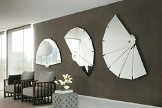 A gray living room with mirror decorations.