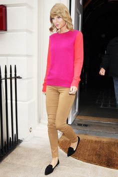 What Taylor Swift Wears On A European Vacation #refinery29 www.refinery29.co... Jeans and a sweatshirt can be kind of boring. Instead, Taylor choose a neon, colorblocked knit that chased away the doldrums of London's gloomy weather.    1