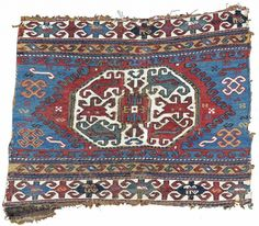 This energetically drawn sumak end panel was woven in the Moghan region of the Caucasus. A central octagon is traced with rams' horn motif, extending from both the top and bottom across ...