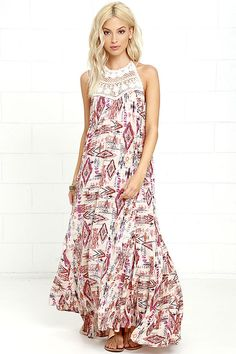 The Billabong Shine On Beige Print Maxi Dress is perfect to throw on after a day of catching waves! From a tying, crochet halter bodice (in cream), gauzy rayon flows in shades of magenta, orange, and rust. Open back has a bit of elastic atop the flowing, full maxi skirt.