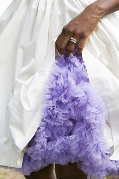 Loving the peek of purple under her adorable wedding dress!