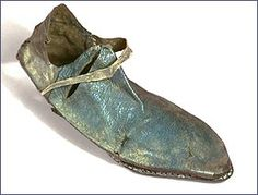 """Medieval shoes were made inside out on a last, stitched along the seams and made without separate heels. This is known as the 'turnshoe' method. They were not very waterproof and wooden pattens or overshoes were often worn with them outside the house. Leather working was an important trade in medieval St Albans. French Row was originally known as """"Cordwainers Row"""" i.e. Shoemakers Row."""