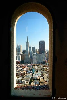 View of Downtown San Francisco from Coit Tower. The coins on the window sill are from countries all over the world.