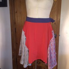 MoonCollection, multi colored skirt MoonCollection skirt,  with each side panel adorned with a floral pattern in orange and blue. Also, the panels are angled longer than the front, and back. This sweet gem consists of rayon, poly, and cotton, nicely  lined.,  and tag indicates hand wash. Waist measures 14 1/4 from side to side. As the pic shows the hook is broken, but will be repaired when you purchase it. cause  no how to sew! don't let this one pass you by!!! If you know this brand, this…