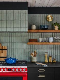 This dreamy kitchen features our Glazed Thin Brick in a straight set pattern. Click the link to see more! Kitchen Tiles, Kitchen Redo, Kitchen Cabinets, Kitchen Design, Mid Century Modern Kitchen, 1960s Kitchen, Black Brick Fireplace, Glazed Brick, Thin Brick