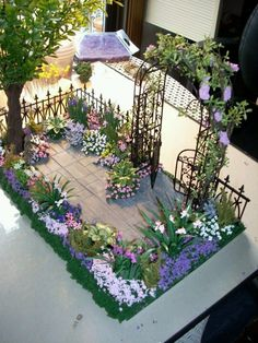 miniature garden, I need to do this with my plant tray on my coffee table, it would be so cute with a fence and gate