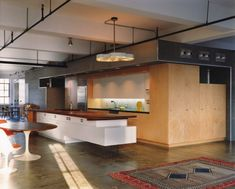 Kitchen and Dining space | The Loft of Frank and Amy in New York City by Resolution: 4 Architecture |