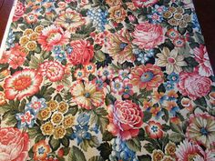 This is one in a series of beautiful Colonial Williamsburg like fabrics I have in my shop.  This piece is an all over floral print in all the typical colonial corals, blues, greens & ecru colors.  This fabric could be use to make a throw or lap quilt, a duvet cover, pillow or cushion covers, table runner, window valance etc. 2 pieces: 3 running yards 1 1/4 running yards priced by the 1/2 yd