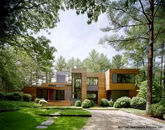 Amazing Modern House Wooden Wall With Large Front Yard Surrounded
