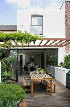 Nice transition from indoors to outside with this lovely Pergola and outdoor dining space.