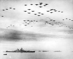 TOKYO — Fighter planes fly in formation overhead as the surrender ceremony to end World War II is held aboard the warship Missouri on Sept. 2, 1945.