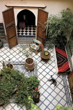 Moroccan courtyard -- I love these Mediterranean inspired walled gardens. There's nothing like it for privacy and serenity.