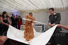 CROQUE EN BOUCHE DEMOLISHED AT DANIELLE AND JOHN'S BAMBURGH CASTLE WEDDING, NORTHUMBERLAND, ENGLAND