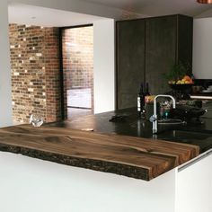 Wowee It s absolutely stunning Thank you so much for putting so much care into creating this for us Jo Martin Sussex Wild English Walnut Breakfast Bar featuring bark preservation resin enhanced features Modern Kitchen Design, Interior Design Kitchen, Brick Interior, Home Decor Kitchen, Kitchen Living, Wooden Worktop Kitchen, Kitchen Stone Wall, Marble Kitchen Countertops, Wood Kitchen Island