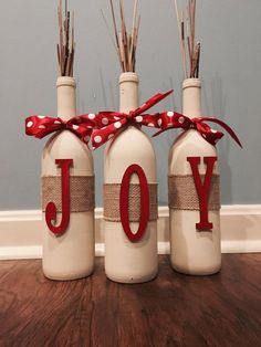 This made-to-order wine bottle set is the perfect compliment to your holiday home decorations. Wine bottles are hand-painted in cream chalk-paint and adorned with burlap wrap and festive red bows. JOY letters and ribbon are available in red or green (letters and ribbon to match). Standard wine botte size measuring 12 inches tall. I am happy to take custom orders- please message for details