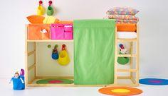 KURA children's reversable loft bed and orange STICKAT bed textiles.